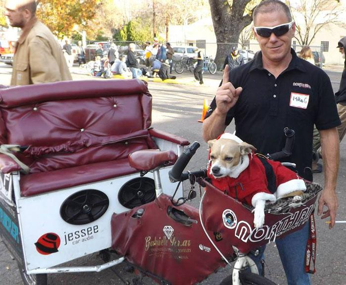 Mike Griffith's dog, Little G, is with the pedicab driver every pedal of the way and even dresses up with Griffith depending on the holiday. Photo courtesy of Mike Griffith.