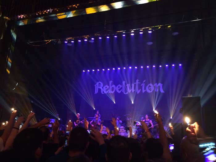 Audience members raised their lighters, synchronizing with the music as Santa Barbara reggae band, Rebelution performed. Photo credit: Greta Gordon