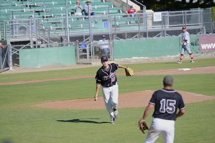 First year pitcher Hunter Haworth tosses the ball to senior Dylan Garcia to beat a Cal State Dominguez Hills batter from getting on base in a game on April 10. Photo credit: Ryan Pressey