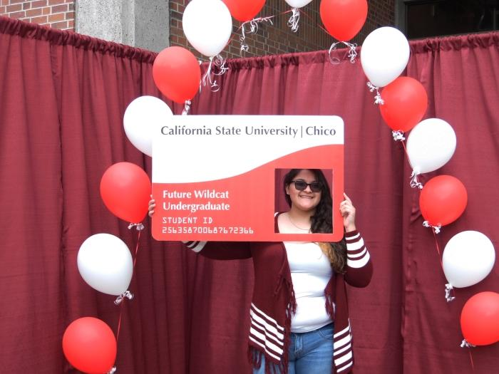 Chico State 2015 freshman, Angeles Zinzun-Ochoa poses in the Choose Chico! photo booth. Photo credit: George Johnston