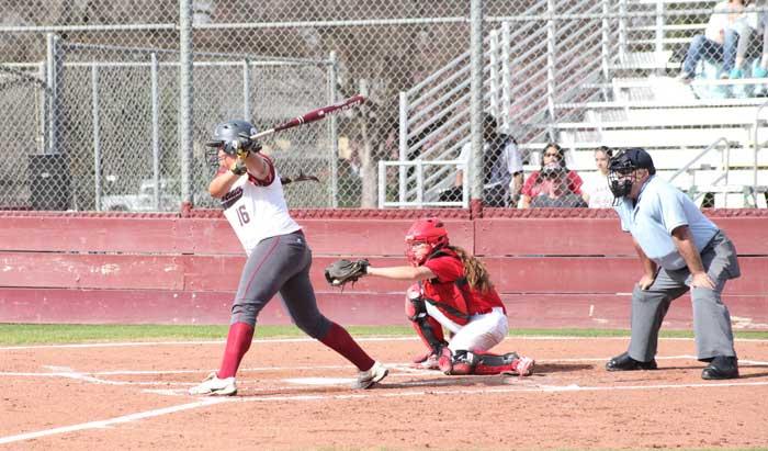 Junior first baseman Desiree Gonzalez bats on Feb. 12 against Hawaii Hilo. Photo credit: Caio Calado