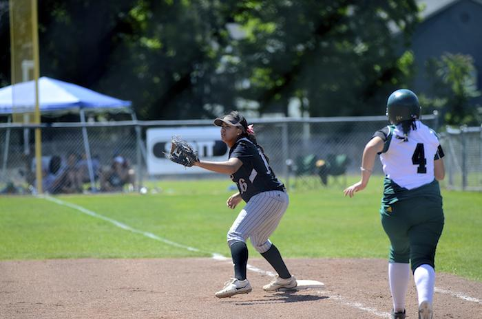 Junior first baseman Desiree' Gonzalez tries to get out a runner on April 3 in a game against UC San Diego. Photo credit: Ryan Pressey