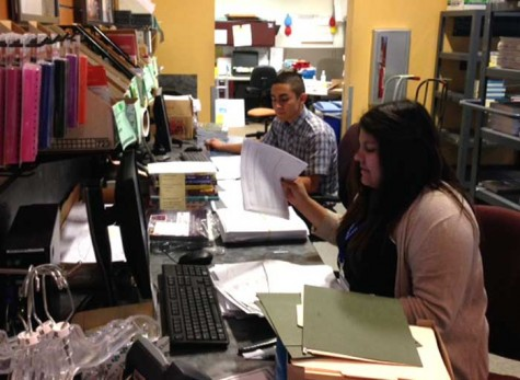 Wildcat Store employees Ruben Ruiz, a first-year sociology major, and Victoria Diaz, a sophomore sociology major, get ready for the end-of-semester book return rush. Photo credit: Michael Arias