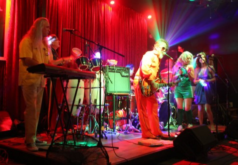 From left: Greg Spont, keys; Jerry Morano, congos; Scott, drums; John McKinley, lead vocalist/guitarist; and Susan Guevara and Cherianne Brandt Pollastrini rock the audience at The Maltese on Saturday August 22. Photo credit: John Domogma