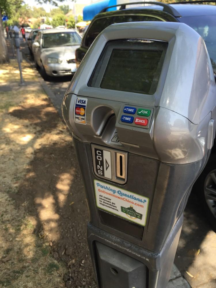 New parking meters installed on campus will no longer accept change as an acceptable form of payment. The updated meters will now only accept Visa or MasterCard in an effort to be more sustainable. Photo credit: Carly Plemons