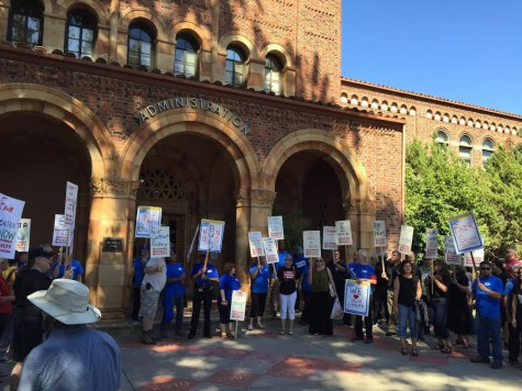Rally members protest for change in front of Kendall Hall. Photo credit: Michael Catelli