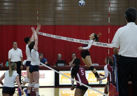 Shannon Boling, senior, earns another kill in her 2015 Wildcat season. Photo credit: John Domogma