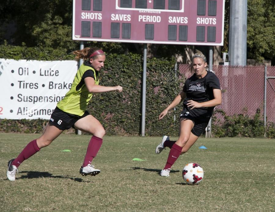 Shelby Lanksbury (left), junior forward, says having families on the women's soccer team is a fun way to make lasting connections. Photo credit: Jenelle Kapellas