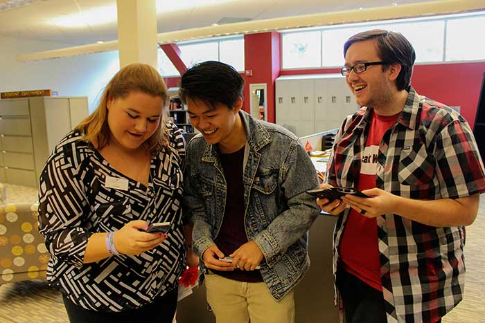 From left: Leanne Woods, Associated Students staff member, Vu Nguyen, executive VP of Associated Students and Michael Pratt, officer for Associated Students, watch the Chico State Snapchat story on Tuesday morning. Photo credit: Kiana Alvarez
