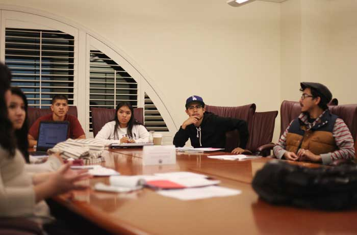 Members of LEAD meet to discuss ways to inform people on campus of their status as undocumented students. Photo credit: John Domogma