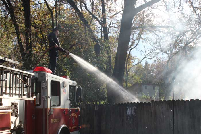 Chico Fire Department putting out a trash fire near Warner Street in an alley on Monday afternoon. Photo credit: Lars Gustafson