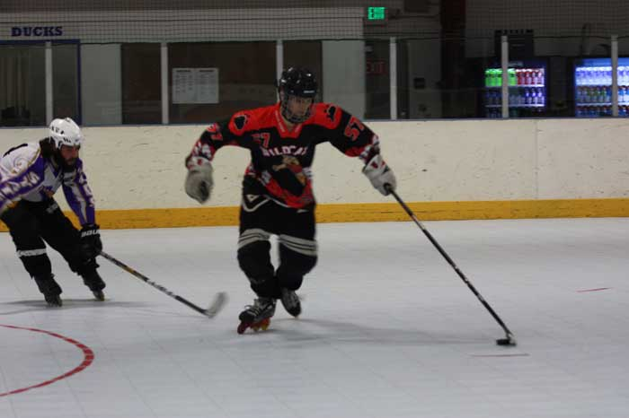 Junior defenseman Cole Euell fights for the puck during a scrimmage. Photo credit: Allisun Coote