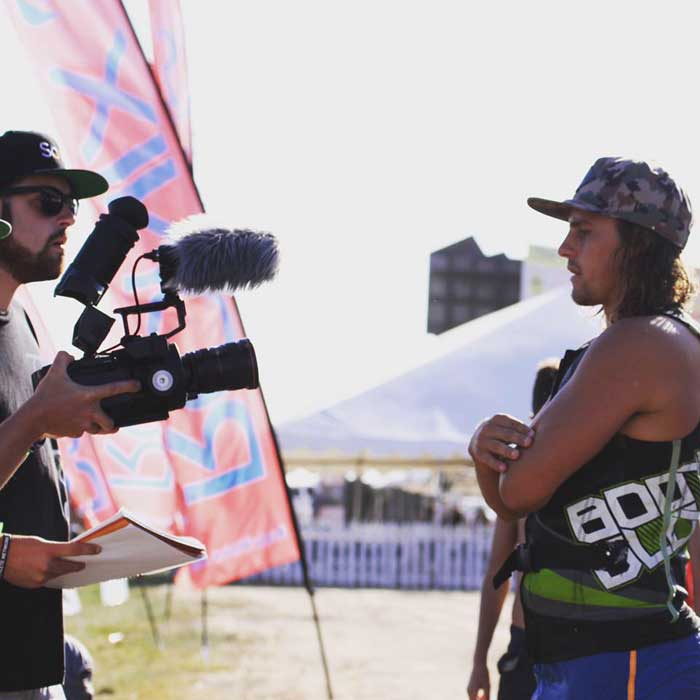Lars Gustafson interviews professional wakeboarder Harley Clifford at the Pro Wake Tour in Lathrop. Photo courtesy of Lars Gustafson.