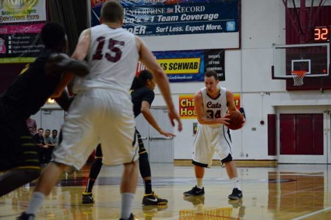 Senior forward Drew Kitchens looks for a pass to senior center Tanner Giddings. Photo credit: John Domogma