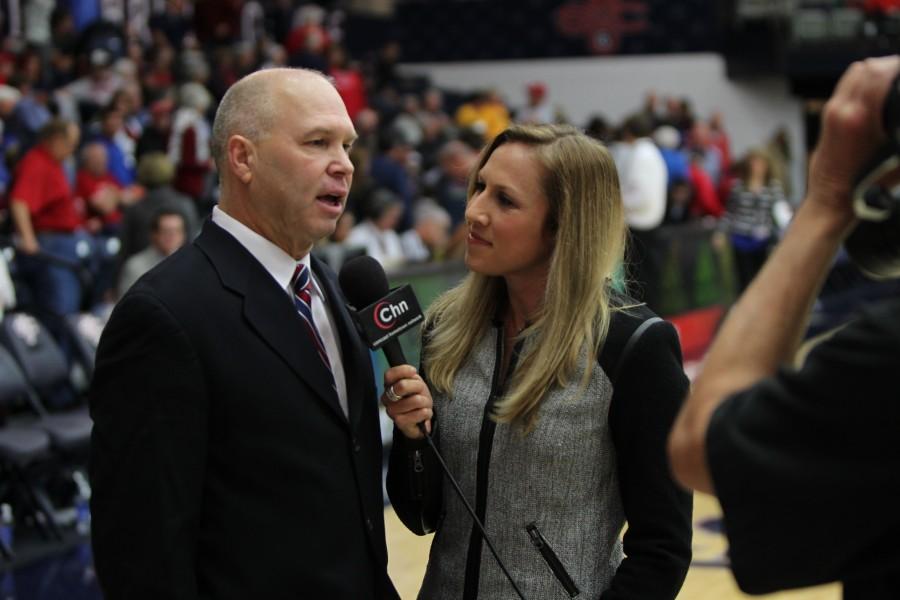 Kate Scott interviews Saint Mary's College men's basketball head coach Randy Bennett for Comcast. Photo courtesy of Kate Scott.