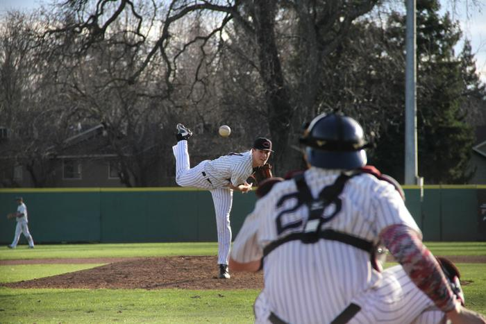Junior Stuart Bradley warms up before an inning against Menlo College on Jan. 30. Photo credit: Jacob Auby