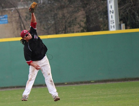Tony Roque jumps high to catch the ball during a scrimmage on Jan. 21. Photo credit: Lindsay Pincus