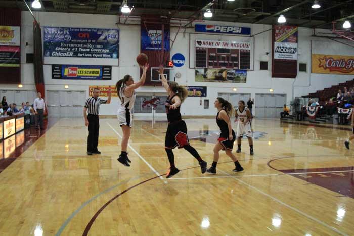 Senior Brooke Bowen shoots a contested shot against Simpson University on Jan. 23. Photo credit: Cam Lesslie