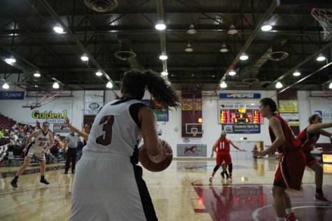 Sophomore Whitney Branham inbounds the ball against Cal State East Bay in a game on Feb. 5. Photo credit: Jacob Auby