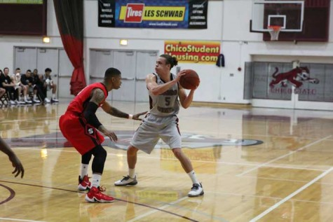 Junior guard Robert Duncan looks to pass in a game against Cal State Stanislaus on Jan. 30. Photo credit: Jordan Olesen