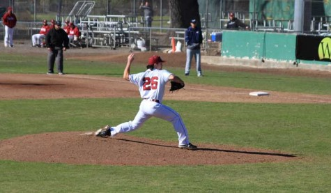 Senior pitcher A.J. Epstein winds up to pitch against Menlo College on Jan. 31. Photo credit: Cam Lesslie