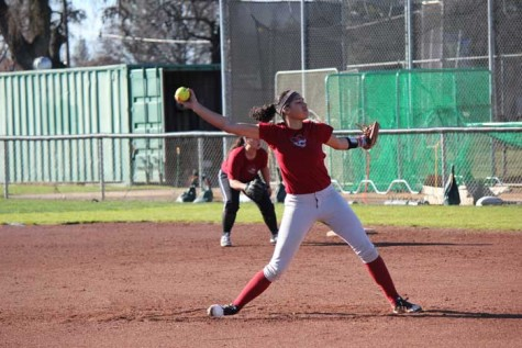 Junior Cailin Garmon pitches the ball during practice on Jan. 27. Photo credit: Lindsay Pincus
