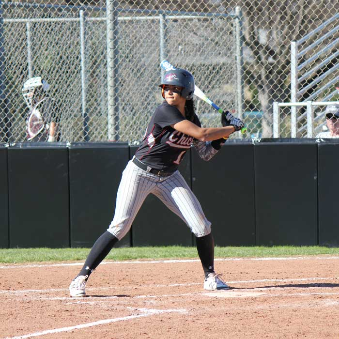 Junior+Cailin+Garmon+swings+at+the+ball+during+the+game+against+Dominican+University+on+Feb.+7.+Photo+credit%3A+Lindsay+Pincus