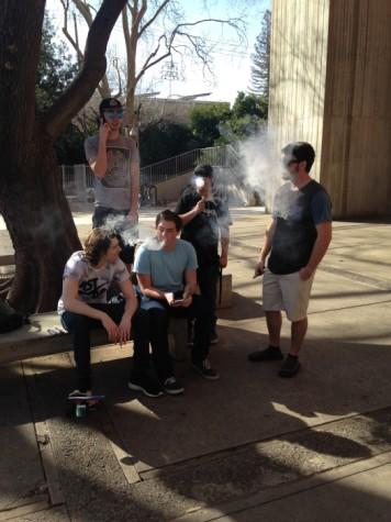 Chico State students smoking in the smoking area by Whitney Hall Photo credit: Amelia Storm
