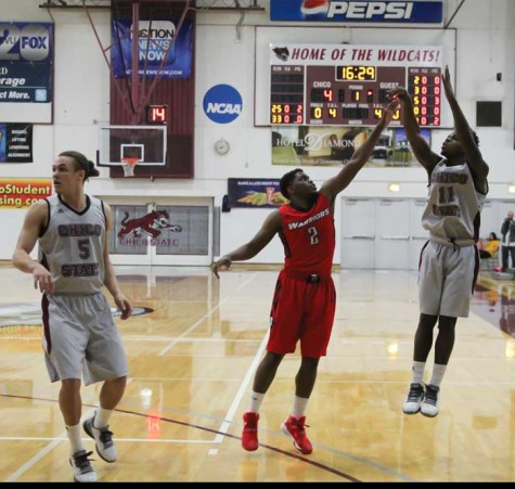 Sophomore Jalen McFerren takes a shot against Cal State Stanislaus while junior Robert Duncan looks for the rebound. Photo credit: Jordan Olesen