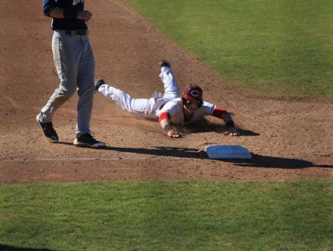 Sophomore third baseman Cameron Santos slides into third against Menlo College on Jan. 31 Photo credit: Cam Lesslie