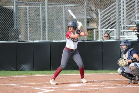 First-year Ari March prepares to hit the ball during the game against Monterey Bay on Feb. 20. Photo credit: Lindsay Pincus