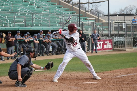 Junior catcher Dillon Kelley loads up for the pitch in a game against Academy of Art. Photo credit: Lindsay Pincus