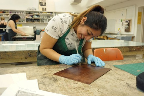 Jazmin Gonzalez, senior art major with an emphasis in printmaking, came across the art of printmaking in the studios and classrooms of Chico State. Photo credit: Floritzel Salvador