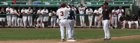Sophomore infielder Cameron Santos celebrates a triple with the dugout in a game against Cal State Monterey Bay. Photo credit: Allisun Coote