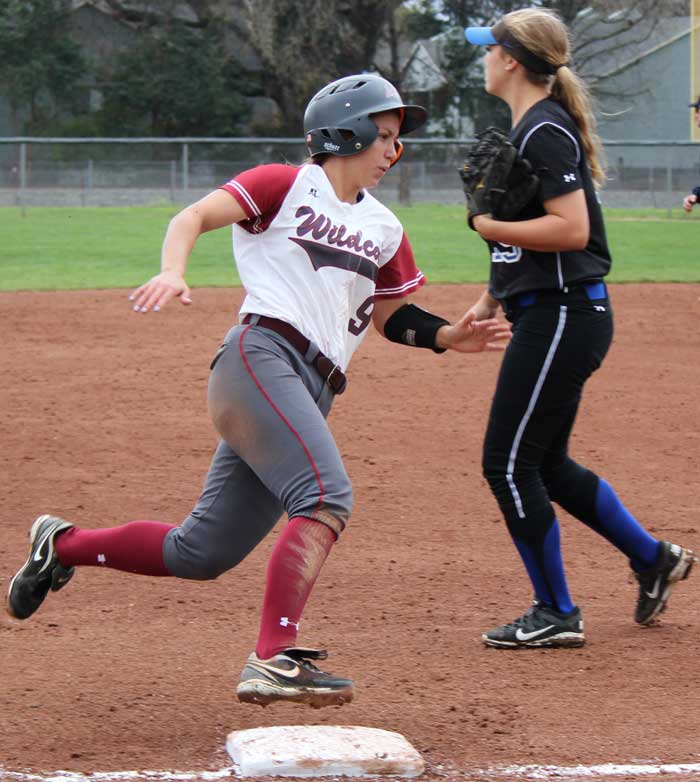 Senior outfielder Alli Cook rounds third base on her way to score for the Wildcats. Photo credit: Lindsay Pincus