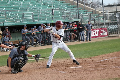 Junior shortstop Casey Bennett loads up before a pitch during a game against Academy of Art. Photo credit: Lindsay Pincus