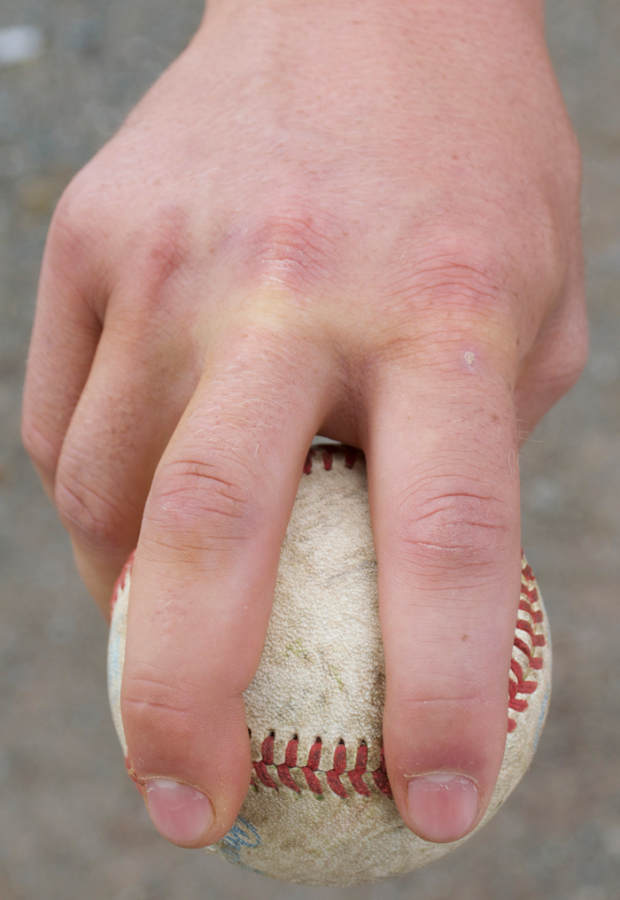 Junior pitcher Clayton Gelfand displays his four-seam fastball grip on the baseball. Photo credit: Danielle Pubill