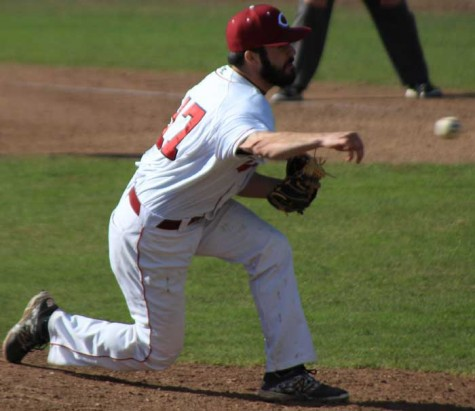 Junior pitcher Grant Wright launches the ball from his unorthodox side-arm delivery. Photo credit: Cam Lesslie