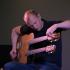 Ian Ethan Case tunes his 18-string acoustic guitar. Photo credit: Aurora Evans