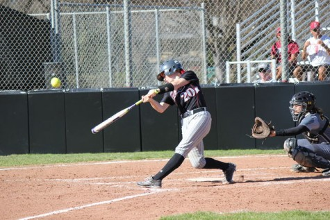 Senior catcher Brynn Lesovsky launches the ball off her bat during a game. Photo credit: Lindsay Pincus