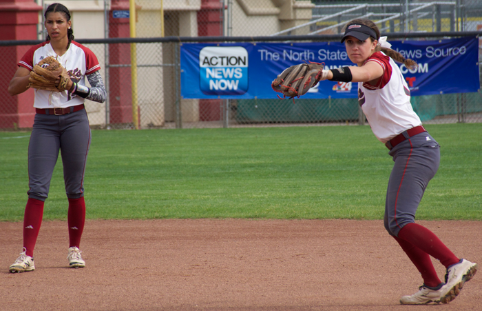 First-year Rachel DeHart winds up before an inning as junior Cailin Garmon waits at shortstop in a game against Cal State Dominguez Hills. Photo credit: Nick Martinez-Esquibel