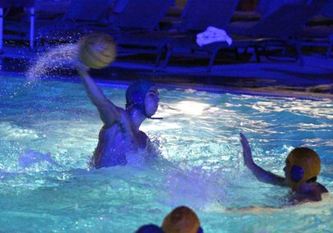 Chico State men's water polo attempts to score. Orion Stock Photo