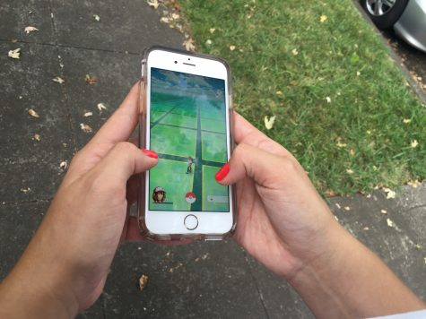 Chico State student plays Pokemon Go. Photo credit: Carly Plemons