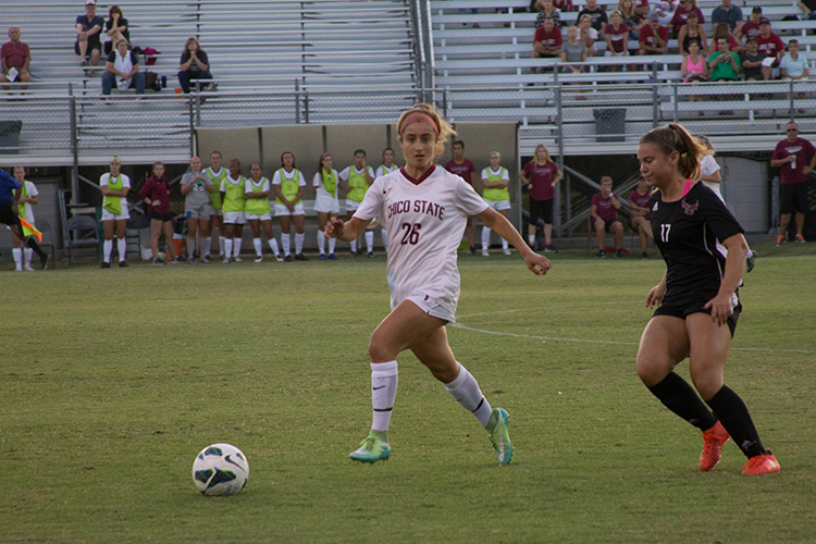 Junior defender Brooke Coelho looks for a teammate to pass the ball to. Photo credit: Aubrie Coley