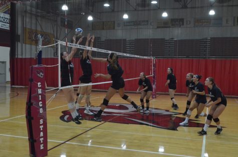 The women's volleyball team practices before their game at the Route 92 Showdown. Photo credit: Jordan Jarrell
