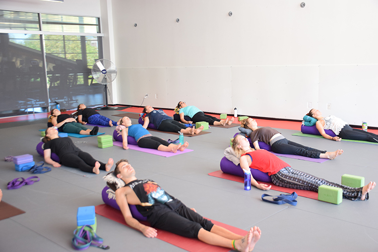 Students relax with their yoga classes at the WREC during the day. Photo credit: Royal T Lee-Castine