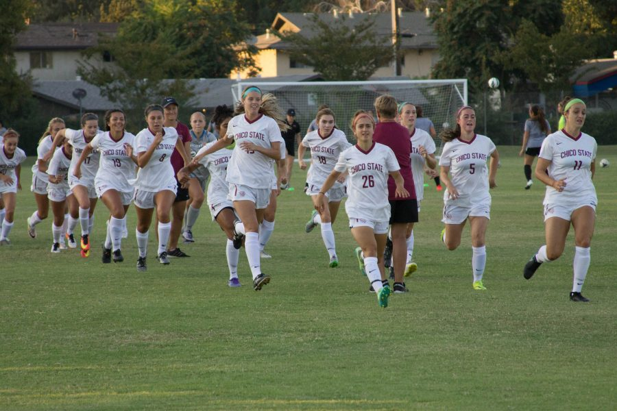 Chico State women's soccer charges onto the field during their first home game of the season. Photo credit: Aubrie Coley
