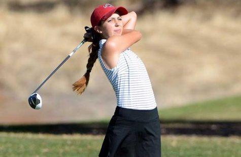 Abbey McGrew takes a swing in a tournament last year. Photo Courtesy of Abbey McGrew