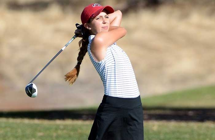 Abbey McGrew takes a swing in a tournament last year. Photo Courtesy of Abbey McGrew