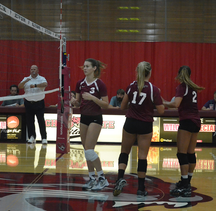 Kim Wright gets prepared for the next set during a Chico State home game. Photo credit: Jordan Jarrell
